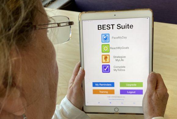 individual looking at BEST Suite app on iPad